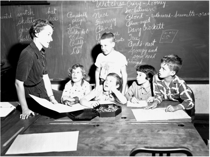 1955 - P.K. Yonge Teacher teaching a group of young students about witches
