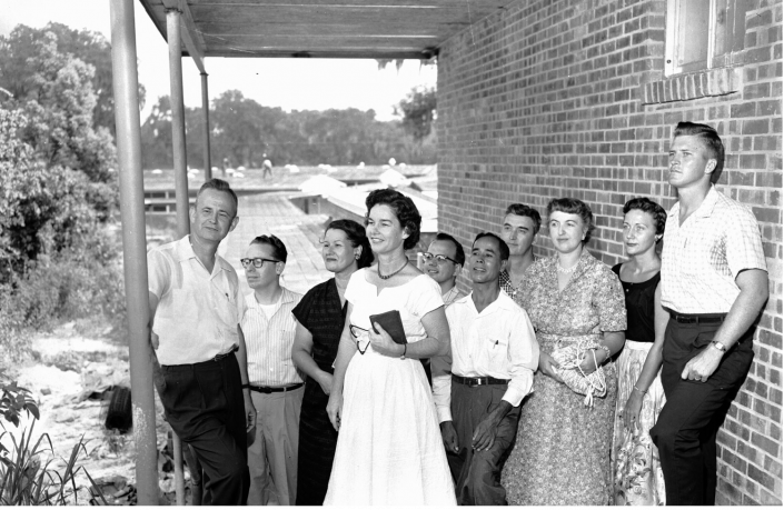 1957 - P.K. Yonge Teachers standing under an awning at the school