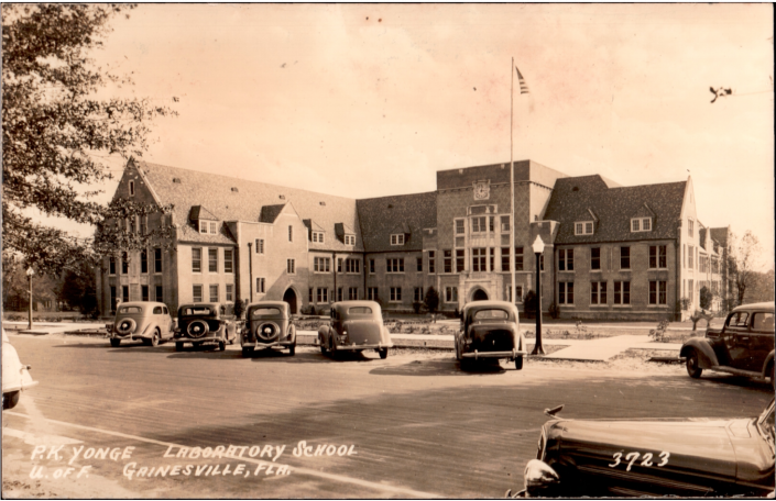 P.K. Laboratory School Building with older style cars parked out front of building
