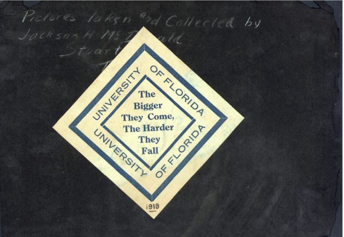 "1917-1925 Scrapbook Page from Jackson MacDonald that has a seal that says, ""The Bigger They Come, The Harder They Fall."""