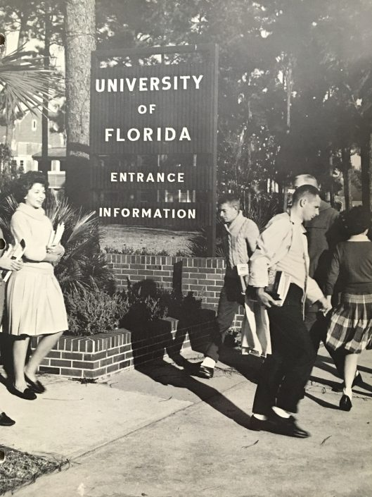 UF Welcome sign with students