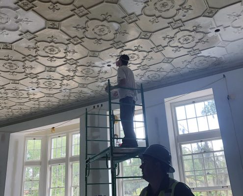 ason Diven, project manager with Scorpio., discussing the ceiling restoration