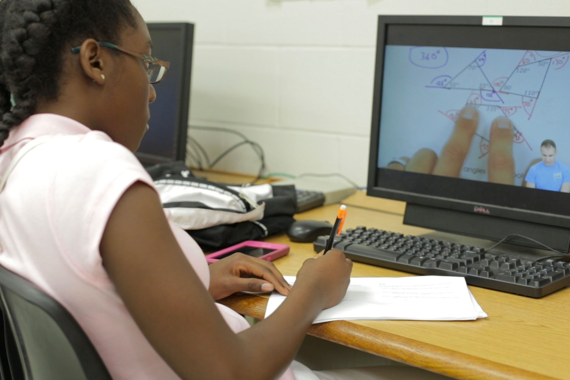 A female student uses Algebra Nation on a computer in her classroom to learn math concepts.