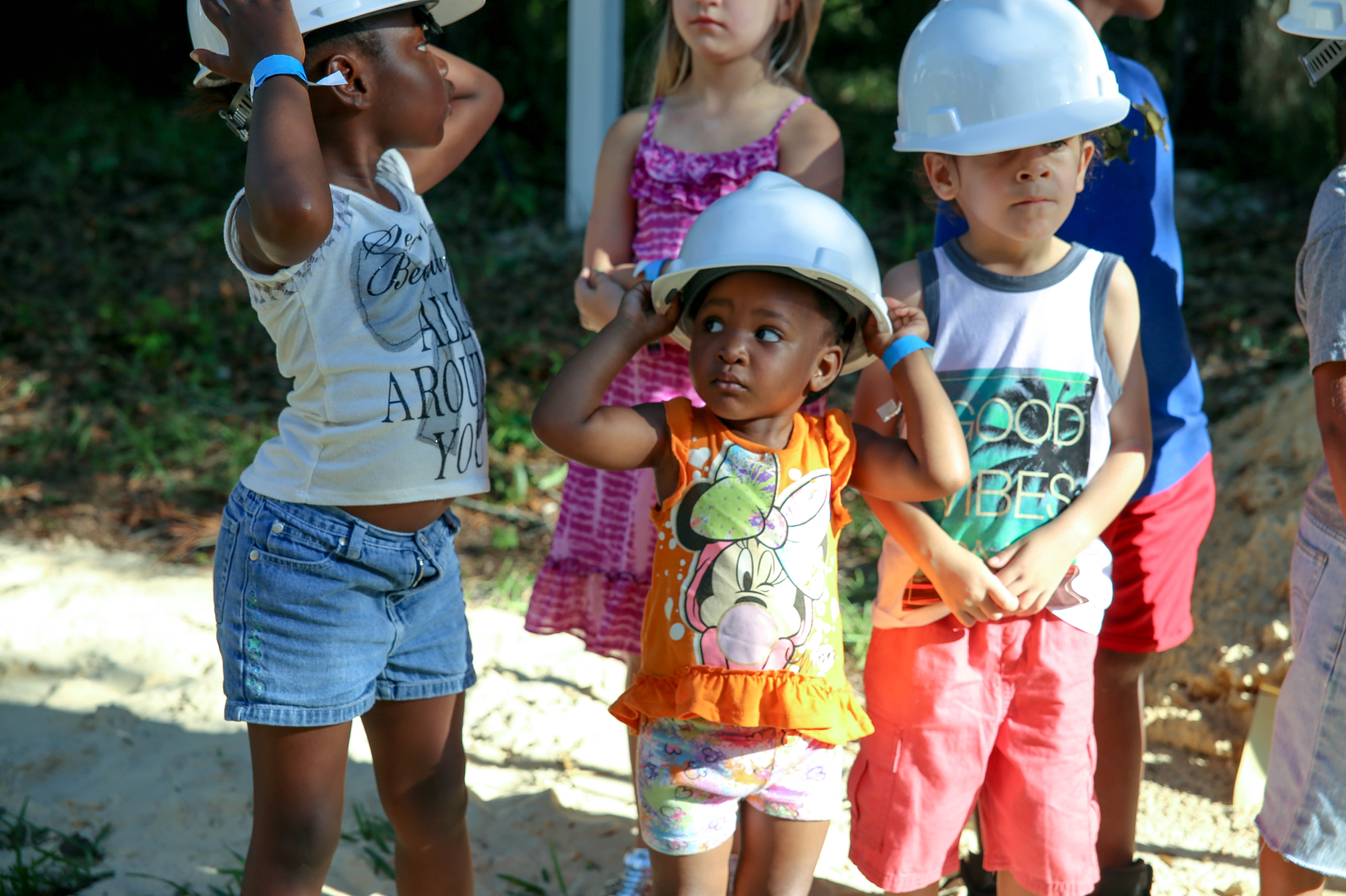 Children wearing hard hats at the SWAG Groundbreaking Event.