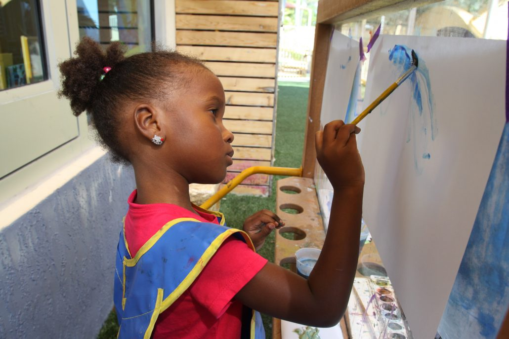 Young student painting.