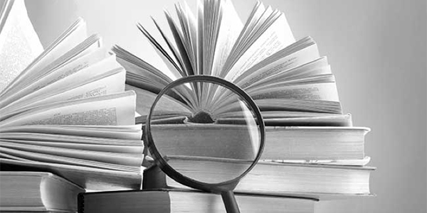 Library book and magnifying glass