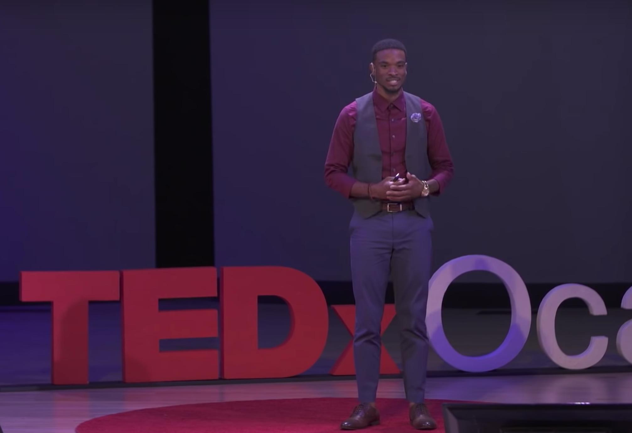 Caleb Chambliss giving TEDx talk