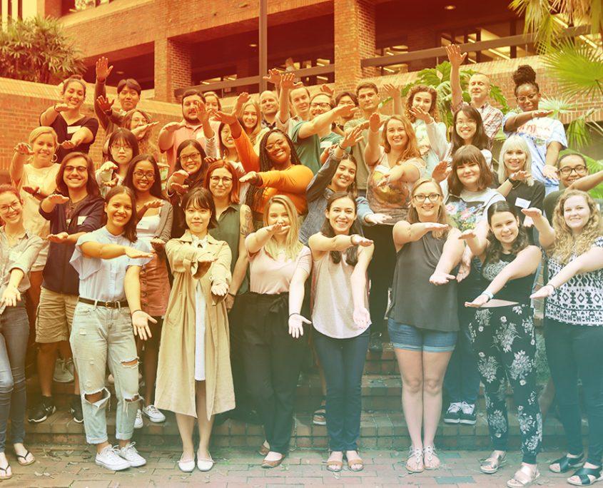 2019 Master's cohort standing in Norman Courtyard