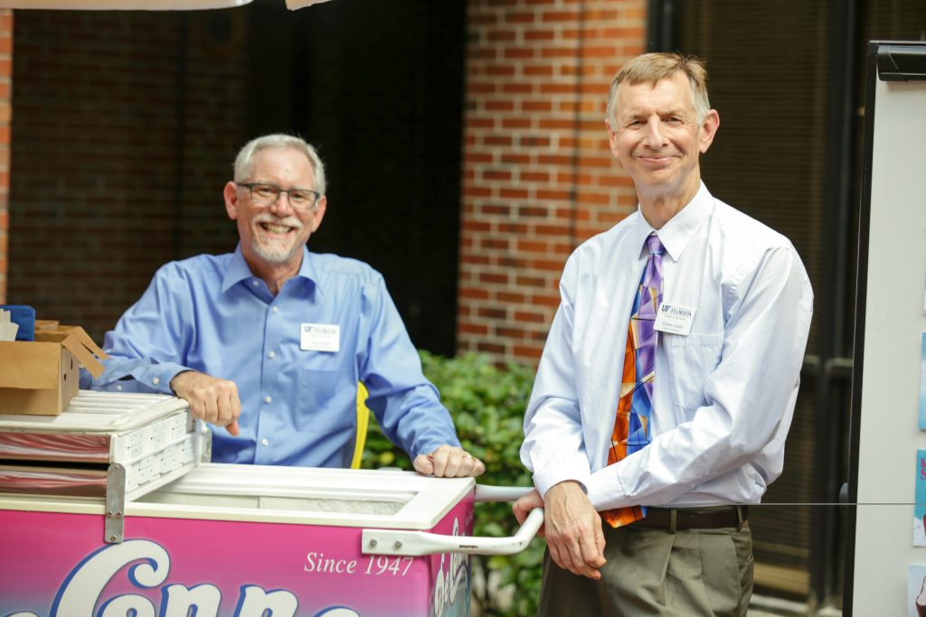 Dr. Tom Dana and Dr. Glenn Good handing out ice cream to students at the ice cream social in 2017.