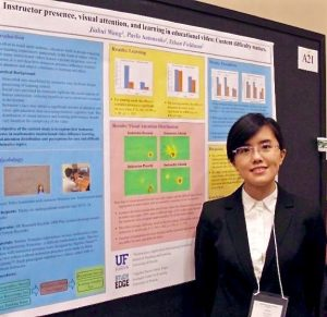 Jiahui Wang poses with her award-winning poster