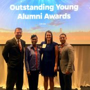 2018 Outstanding Young Alumni with Associate Dean Thomasenia Adams and Sr. Director of Development Brian Danforth