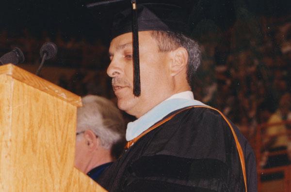 Gerardo Gonzalez speaking at a graduation event