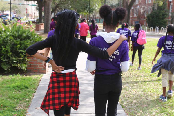 Two students walking together