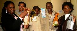UF counselor education doctoral student Dadria Lewis (above, second from left) is pictured with Botswana Women's Shelter staff members receiving donated toiletries for shelter residents.