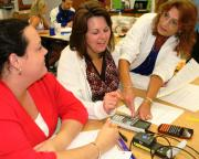Teachers perform a math exercise at a UF-hosted summer institute, part of the Florida PROMiSE program.