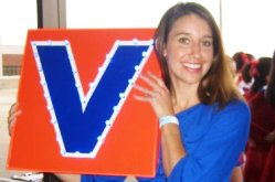 "Rose Gleichowsil holding up a ""V"" award"