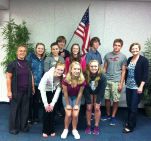 PKY elementary principal Cathy Atria (left) and technology coordinator Julie Henderson (right) flank nine of the 13 traveling Blue Wave student delegates before embarking on their China trip.