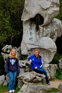 Paige Crumpton and Luisa Schlafke pose with a structure in China.