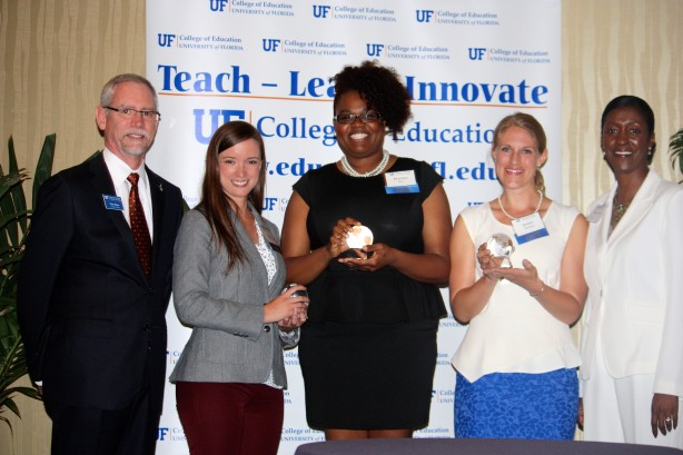 COE associate deans Tom Dana (left) and Thomasenia Adams (right) flank the college's Outstanding Graduate Student Award recipients (from left) Rachel Wolkenhauer, Kiwanis Burr and Amber Benedict at the college's recent Recognition Dinner.