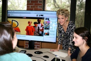 STL Associate Director Suzanne Colvin is shown with ProTeach students in the tech-enhanced classroom.