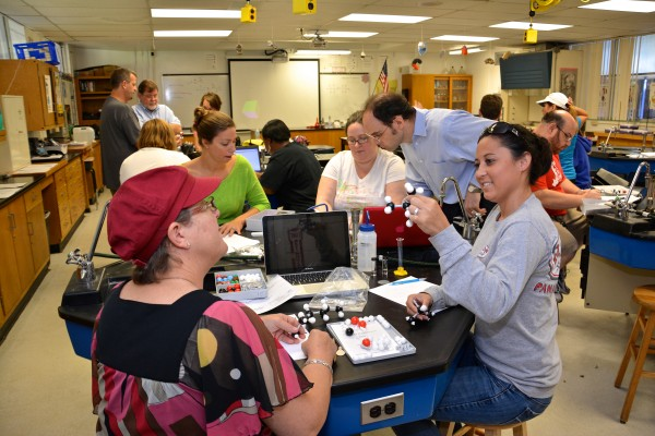Palm Beach County science teachers construct an atom model at a UF Summer Institute on chemistry instruction recently at UF's P.K. Yonge Developmental Research School.