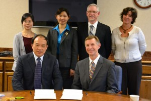 "Pictured at Tuesday's agreement signing ceremony in Norman Hall are: (seated) Dr. Weizhou Liu, VP, NXU, and UF COE dean Dr. Glenn Good; (standing from left) Dr. Juan ""Angela"" Zhao of International Exchange Office, Dr. Huying Cao, executive dean of NXU School of Teacher Education; UF COE associate dean Dr. Tom Dana, and UF International Center executive director Susanne HIll."