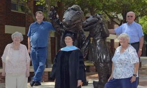 Jo Kenney (center) poses with her family before UF's commencement for doctoral graduates. Pictured with her in front row are her mother, Susan Kenney, and her aunt, Carolyn Barczc; back row are her brother, Jeff Kenney, and her father Robert Kenney.