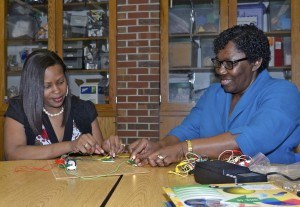 Natalie King (left) and Rose Pringle, King's faculty adviser, work together on a science project.