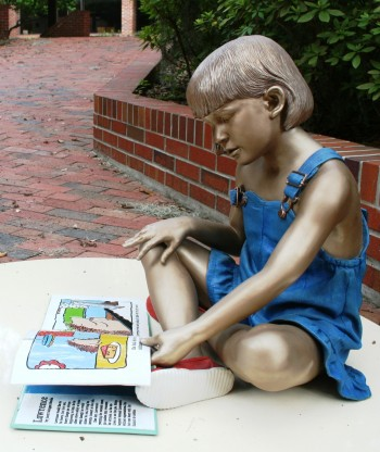 UF's online master's in reading program is nationally accredited and addresses the standards and competencies required of Florida educator certification for teaching K-12 reading. Pictured, depicting the youthful pleasures of reading, is a bronze-painted, life-like statue by American sculptor Seward Johnson that was on display in UF's Norman Hall courtyard in the summer and fall of 2011.