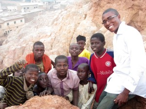 Monroe poses with a group of kids he met in Kano, Nigeria, where he conducted research as a UF undergraduate.