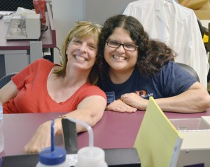 Kathy Savage participates in a laboratory exercise during the summer program with Houda Darwiche, a post doctoral fellow with the Center for Precollegiate Education and Training.