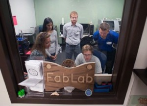 Workshop participants visit the University of Florida's Fab Lab to print a model of a fossil horse tooth.