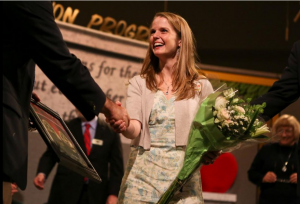 Lauren Marlowe, a graduate of the College of Education at the Unviersity of Florida, receives the Alachua County School District's Teacher of the Year award. (Photo courtesy Gainesville Sun, Emma Green)