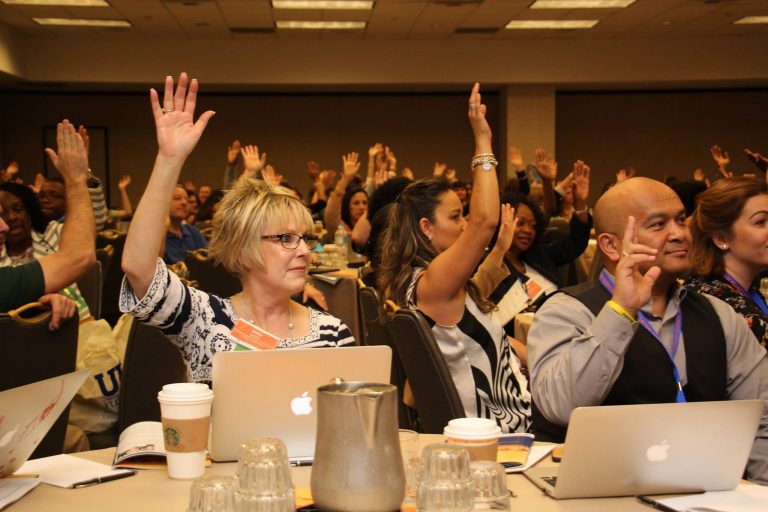 Attendees respond to a question at the International Teacher Leadership Conference.