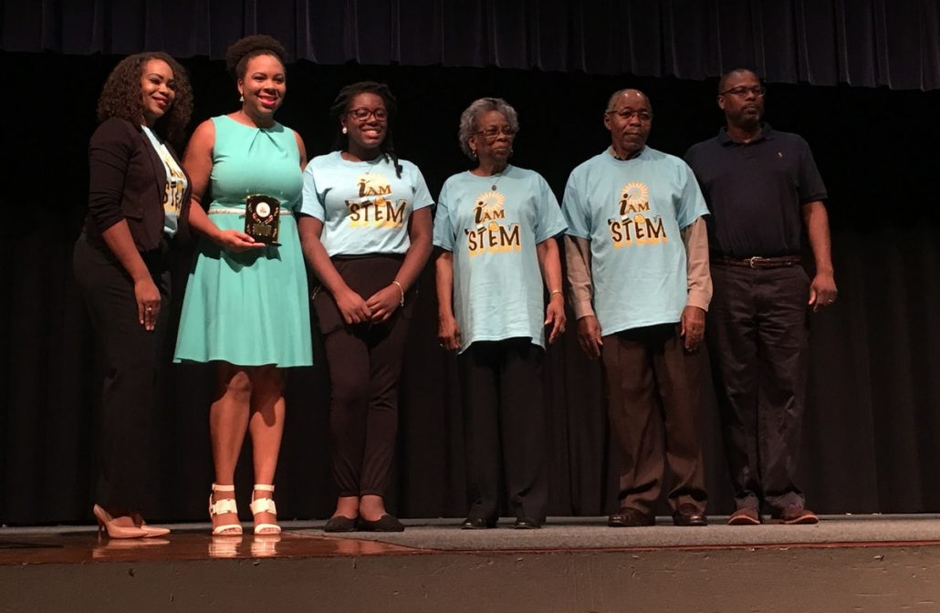 Participants of the I AM STEP Camp standing on stage