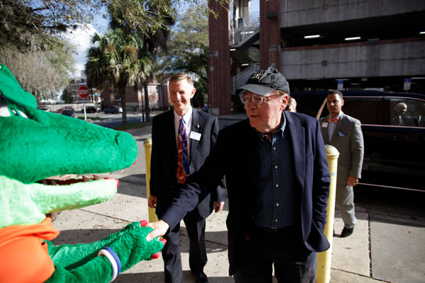 James Patterson shaking Alberta the Alligator's hand