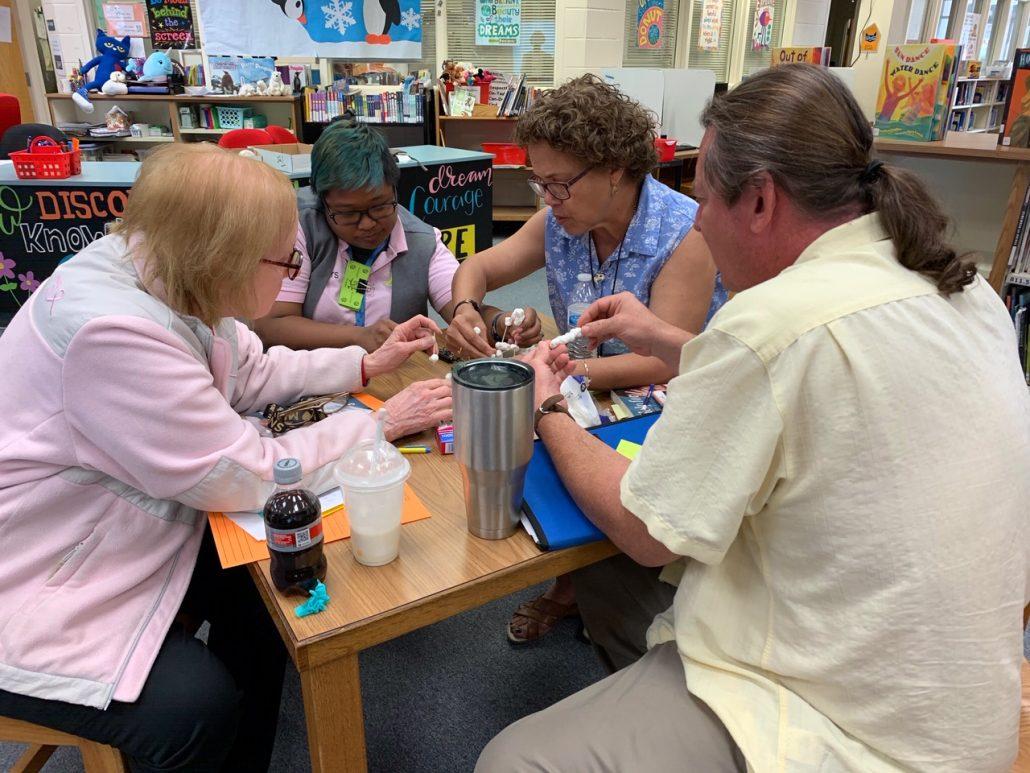Teachers collaborate on a team-building activity.